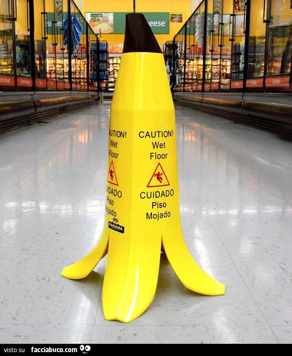 Attenzione pavimento bagnato a forma di buccia di banana ...